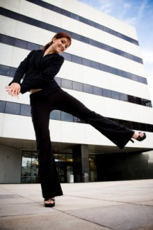 Woman dancing in front of office building